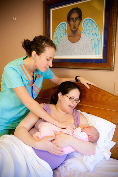 midwife with new mom and baby